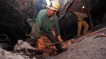 Miners work underground at the Harmony Goldmine, near Carletonville, South Africa, in this Oct. 27, 2004 file photo. (Themba Hadebe/AP/Themba Hadebe/AP)