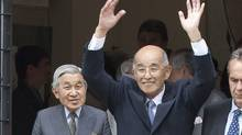 Cy Saimoto, centre, got a chance to escort visiting Japanese Emperor Akihito, left, in Vancouver in July 2009. (Andy Clark/Reuters)