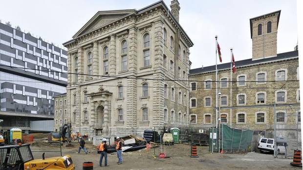Scaffolding recently came down at the Don Jail, revealing the restoration of the 148-year-old building in Toronto. It is being repurposed as administrative offices for the new glass-exterior Bridgepoint hospital, left, and will reopen next spring. (Mario Madau/+VG Architects)