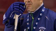 Vancouver Canucks head coach Alain Vigneault looks on during the second day of training camp in Vancouver, British Columbia January 14, 2013. (BEN NELMS/REUTERS)