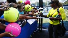Serena Williams signs autographs after practising ahead of the of the 2014 U.S. Open tennis tournament, Sunday, Aug. 24, 2014, in New York. ( (Matt Rourke/AP)