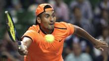 In this Saturday, Oct. 8, 2016, file photo, Australia's Nick Kyrgios returns a shot to Gael Monfils of France during the semifinal match of Japan Open tennis championships in Tokyo. The ATP has suspended Nick Kyrgios for at least 3 weeks and fined him extra $25,000 for conduct contrary to 'integrity' of tennis. (Koji Sasahara/AP)