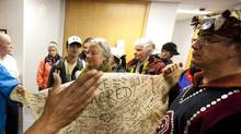Protesters try to deliver a petition signed on deer skin during the first day of testimony in the salmon inquiry in Vancouver October 25, 2010. (John Lehmann/The Globe and Mail/John Lehmann/The Globe and Mail)