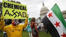 A group of Syrian Americans rally in favour of proposed U.S. military action against the Bashar al-Assad regime outside the U.S. Capitol on Sept. 9, 2013. (JONATHAN ERNST/REUTERS)