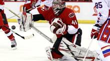 Ottawa Senators' goalie Craig Anderson stops a shot on net during the third period of their NHL game against the Washington Capitals in Ottawa April 18, 2013. (BLAIR GABLE/REUTERS)