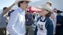 Liberal Leader Justin Trudeau speaks to Alberta Premier Alison Redford during the Premier's Stampede Breakfast in Aldersyde, Alta., on June 7, 2013. (KEVIN VAN PAASSEN/THE GLOBE AND MAIL)