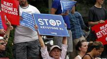 Protesters rally against the Keystone XL oil pipeline as U.S. President Barack Obama's motorcade arrives at the Jefferson Hotel in Washington, July 11, 2013. (Yuri Gripas/REUTERS)