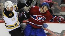 Boston Bruins' Milan Lucic checks Montreal Canadiens' Josh Gorges during third period NHL hockey action in Montreal, Feb. 7, 2010. (Graham Hughes)