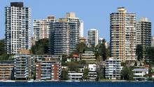 Luxury houses and apartments with multi-million dollar price tags tower over Sydney Harbour. The Australian government has imposed new restrictions on foreign ownership to counter soaring real estate prices. (WILL BURGESS/REUTERS)