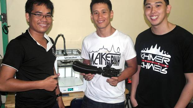 (Left to Right) Von Chan, Ki Chong, Ki How with ARCHUB PNH, showcasing the Victoria Hand System they printed and assembled