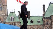 Prime Minister Stephen Harper makes his way off the stage at the Canada Day celebrations on Parliament Hill, in Ottawa Monday, July, 1, 2013. (FRED CHARTRAND/THE CANADIAN PRESS)
