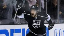 Los Angeles Kings' Drew Doughty celebrates a goal scored by teammate Justin Williams during Game 3 of their NHL Western Co