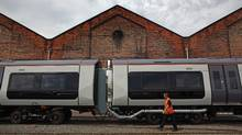 A worker inspects a Bombardier train at the Derby manufacturing facility in this photo from July 5. (Christopher Furlong/Christopher Furlong/Getty Images)