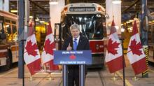 Canadian Prime Minister Stephen Harper makes a policy statement promising federal funding for a Toronto transit project during a speech at a Toronto Transit Commission depot on June 18. (Chris Young/THE CANADIAN PRESS)