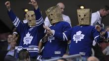 Toronto Maple Leafs fans wear paper bags on their heads during the third period of their NHL game against the New York Islanders in Toronto March 20, 2012. (MIKE CASSESE/REUTERS)