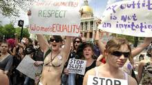 Women march past the Statehouse during the SlutWalk in Boston, Saturday, May 7, 2011. (JOSH REYNOLDS/AP/JOSH REYNOLDS/AP)