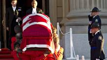The casket holding the body of former Alberta premier Peter Lougheed is carried by the RCMP into the Alberta Legislature in Edmonton where he will lie in state, on Sept. 16, 2012 . (Jason Franson/THE CANADIAN PRESS)