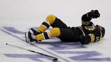 Boston Bruins Nathan Horton lies on the ice after being hit by Vancouver Canucks Aaron Rome during the first period of the NHL Final Game Three between the Vancouver Canucks and Boston Bruins in Boston on June 6, 2011. (Photo by Peter Power/The Globe and Mail) (Peter Power/Peter Power/The Globe and Mail)