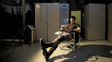 "Actor Sergio Di Zio reads on the set of ""Flashpoint"" in Toronto. (Kevin Van Paassen / The Globe and Mail)"