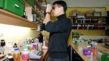President of Happy Planet Foods Raymond Leung uses a refractometer to test the brix (sugar content) in the juice at the head office in Vancouver, BC. (LAURA LEYSHON/LAURA LEYSHON/THE GLOBE AND MAIL)