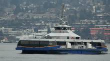 A new SeaBus, the MV Burrard Pacific Breeze, crosses Burrard Inlet from North Vancouver to Vancouver, B.C., on Wednesday December 23, 2009. The new passenger ferry joins two others to provide enhanced service during the Vancouver 2010 Winter Olympic and Paralympic Games. Over the past five years SeaBus has carried more than 5.2 million passengers a year between Vancouver and North Vancouver. Thursday will mark 50 days until the start of the 2010 Winter Olympics. THE CANADIAN PRESS/Darryl Dyck (DARRYL DYCK/DARRYL DYCK/THE CANADIAN PRESS)