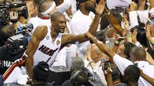 Chris Bosh celebrates after the Miami Heat defeated the San Antonio Spurs Game 7 to win their NBA Finals basketball playoff in Miami, Florida June 20, 2013. Bosh has been sidelined since last February because of complications related to blood clots (JOE SKIPPER/REUTERS)