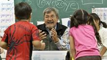 A native elder speaks with students in a traditional language class at Chief Atahm School in Chase, B.C., on Nov. 17, 2010. (Jeff Bassett/Jeff Bassett for The Globe and Mail)