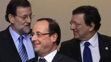 Spain's Prime Minister Mariano Rajoy, from left, France's President Francois Hollande and European Commission President Jose Manuel Barroso gather for photos during a EU summit in Brussels Dec. 13, 2012. (Yves Herman/Reuters)