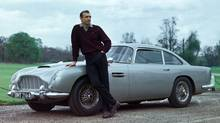 Sean Connery with a 1963 Aston Martin DB5 in Goldfinger, 1964. (Everett Collection)