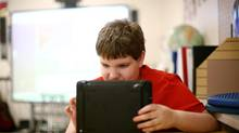 Specialized tablet and phone apps are being developed to help children with cognitive disabilities, such as Braeden Barr, who has severe autism, seen here working on his Ipad at Chimo Public School in Smith Falls, Ont. (Dave Chan For The Globe and Mail)
