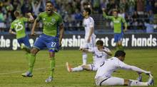 Seattle Sounders' Lamar Neagle (27) celebrates after he scored a goal in the second half of an MLS soccer match against the Vancouver Whitecaps, Saturday, June 8, 2013, in Seattle. (Associated Press)