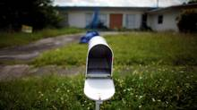 An empty mail box at the front door of a foreclosed house in Miami Gardens, Fla. (CARLOS BARRIA/CARLOS BARRIA/REUTERS)