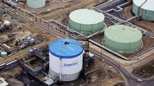 Petroleum storage tanks at the Suncor operations near Fort McMurray are pictured in this 2014 file photo. (TODD KOROL/REUTERS)