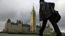 A man approaches Parliament Hill as the sun sets on Oct.18, 2011. (Adrian Wyld/THE CANADIAN PRESS)