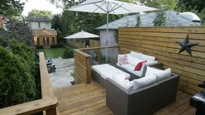 Off the house, a small deck overlooks the rest of the garden.