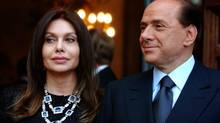 In this Friday June 24, 2004 file photo, then Italian prime minister Silvio Berlusconi, right, and his then wife Veronica Lario wait for then president George W. Bush at the Villa Madama residence in Rome. (Susan Walsh/AP)