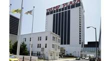 Trump Plaza Hotel and Casino towers over Vera Coking's decrepit three-storey boarding house in Atlantic City, N.J. (Mel Evans/Associated Press)