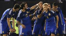 Argentina's Javier Mascherano is congratulated by teammates after he scored his team's second goal against Trinidad and Tobago during their international friendly soccer match in preparation for the World Cup in Buenos Aires June 4, 2014.  (Reuters)