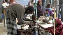 Parents attend to their malnourished child inside the pediatric ward at the Banadir hospital in Somalia's capital Mogadishu, July 19, 2011. (FEISAL OMAR/REUTERS/FEISAL OMAR/REUTERS)