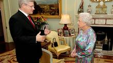 Britain's Queen Elizabeth II talks with Stephen Harper, the Prime Minister of Canada, during a private meeting at Buckingham Palace in central London, Wednesday June 12, 2013. (John Stillwell/AP)