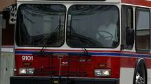A bus makes its way through downtown Kelowna on May 4, 2005. (Jeff Bassett/The Globe and Mail/Jeff Bassett/The Globe and Mail)