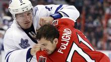 Toronto Maple Leafs' Luke Schenn (L) fights Ottawa Senators' Nick Foligno during the second period of their NHL hockey game in Ottawa March 17, 2012. REUTERS/Blair Gable (Blair Gable/Reuters)