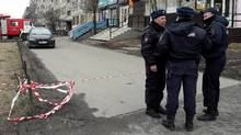 Russian police officers secure a residential area in St. Petersburg, Russia, on April 6, 2017. (STAFF/REUTERS)