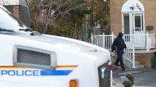 RCMP go in and out of a Toronto house is believed to be the residence of one of two suspects arrested in a foiled terrorism plot on a Via Rail train, Monday April 22, 2013. (Tim Fraser for The Globe and Mail)
