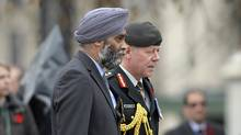 Defence Minister Harjit Singh Sajjan, left, and Chief of Defence Staff Gen. Jonathan Vance attend the Remembrance Day ceremony in Ottawa on Wednesday, Nov. 11. (Adrian Wyld/The Canadian Press)