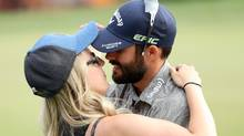 Adam Hadwin of Canada celebrates with fiancée Jessica Dawn after winning the Valspar Championship. (Mike Lawrie/Getty Images)