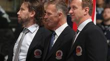 TORONTO, ON - NOVEMBER 16: 2014 Hockey Hall of Fame inductees (l-r) Peter Forsberg, Dominik Hasek, and Rob Blake take part in the Hall blazer presentation prior to the Legends Classic Game at the Air Canada Centre on November 16, 2014 in Toronto, Canada. (Photo by Bruce Bennett/Getty Images) (Bruce Bennett/Getty Images)