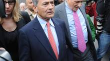 - Former Goldman Sachs board member Rajat Gupta exits Manhattan federal court with his attorney Gary Naftalis, right, following his arraignment, Wednesday, Oct. 26, 2011, in New York. (AP Photo/ Louis Lanzano/AP Photo/ Louis Lanzano)