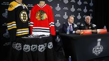 The jerseys of the Chicago Blackhawks and Boston Bruins are displayed during a news conference for the NHL Stanley Cup finals in Chicago, June 11, 2013. The Stanley Cup finals start June 12. (JEFF HAYNES/REUTERS)