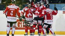 Team Canada's Matt Duchene, 2nd right, celebrates his goal with teammates Cam Barker, left, Josh Holden, second left, and Jason Demers, right, after scoring the 3:0, during the semi-final match between Team Canada and HC Fribourg Gotteron at the 86th Spengler Cup ice hockey tournament, in Davos, Switzerland, Sunday, Dec. 30, 2012. (Salvatore Di Nolfi/AP)